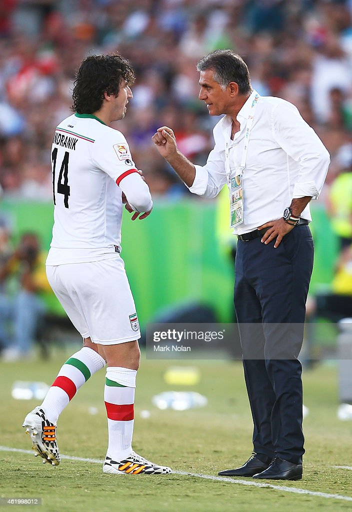 Iranian coach <a gi-track='captionPersonalityLinkClicked' href=/galleries/search?phrase=Carlos+Queiroz&family=editorial&specificpeople=211586 ng-click='$event.stopPropagation()'>Carlos Queiroz</a> (R) talks with <a gi-track='captionPersonalityLinkClicked' href=/galleries/search?phrase=Andranik+Teymourian&family=editorial&specificpeople=551220 ng-click='$event.stopPropagation()'>Andranik Teymourian</a> of Iran during the 2015 Asian Cup match between Iran and Iraq at Canberra Stadium on January 23, 2015 in Canberra, Australia.