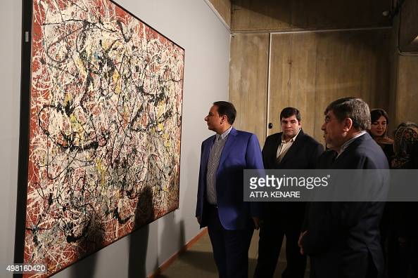 Iranian culture minister ali jannati r looks at us for Mural on indian red ground
