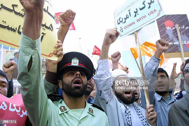 Iranian demonstrators chant slogans in front of the former US embassy in Tehran 04 November 2003 Some 10000 Iranian hardliners gathered outside the...