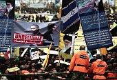 Iranian demonstrators hold a placard bearing portraits mocking US President Barak Obama and Secretary of State John Kerry alongside antiIsrael...