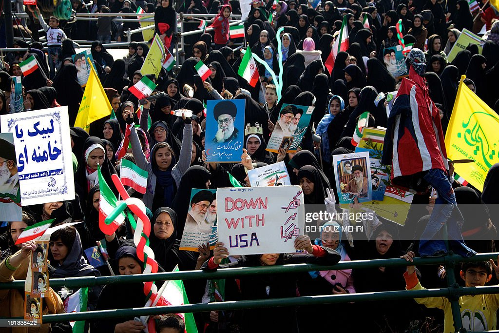 Iranian demonstrators hold anti-US slogans and portraits of supreme leader, Ayatollah Ali Khamenei during a rally in Tehran's Azadi Square (Freedom Square) to mark the 34th anniversary of the Islamic revolution on February 10, 2013. Hundreds of thousands of people marched in Tehran and other cities chanting 'Death to America' and 'Death to Israel' as Iran celebrated the anniversary of the ousting of the US-backed shah.