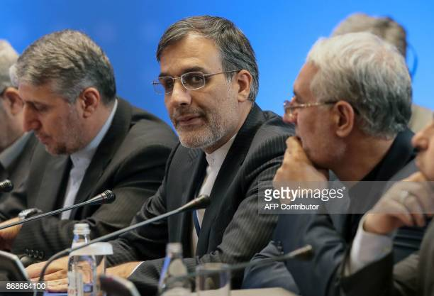 Iranian deputy foreign minister Hossein Jaberi Ansari along with other attendees take part in the session of Syria peace talks in Astana on October...