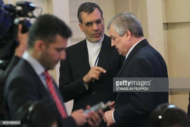 Iranian deputy foreign minister Hossein Jaberi Ansari speaks with Russian mediator Alexander Lavrentiev during the third round of Syria peace talks...