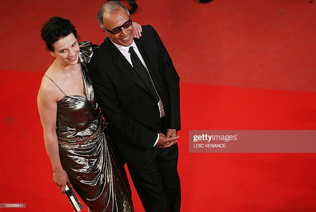 Iranian director Abbas Kiarostami and French actress Juliette Binoche arrive for the screening of 'Copie Conforme (Certified Copy) presented in competition at the 63rd Cannes Film Festival on May 18, 2010 in Cannes.