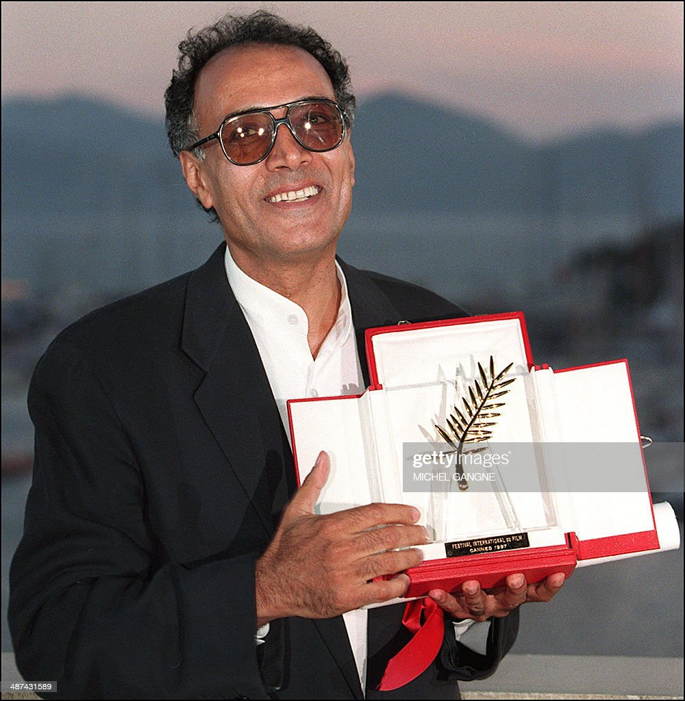 Iranian director Abbas Kiarostami poses for photographers 18 May after he won the Golden Palm for his film 'The Taste of the Cherry' at the 50th...