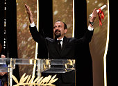 Iranian director Asghar Farhadi celebrates on stage after being awarded with the Best Screenplay prize for the film 'The Salesman ' during the...