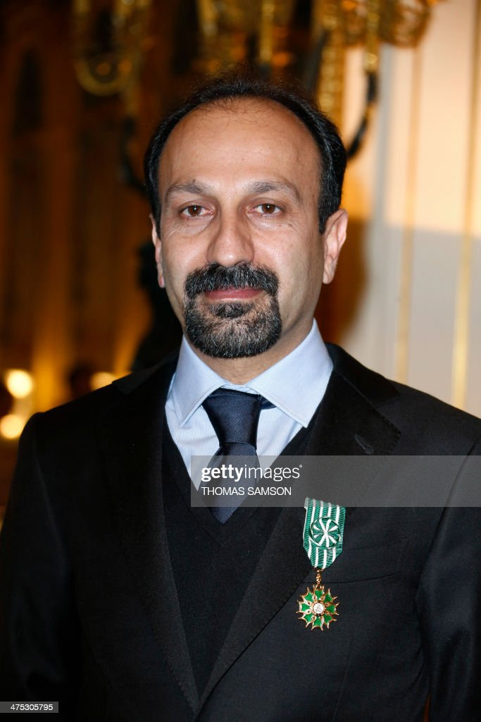 Iranian director Asghar Farhadi poses for a photograph after being awarded an 'Officier des Arts et Lettres' medal by the French Minister of Culture, in Paris, on February 27, 2014. Farhadi, who directed the Oscar-winning Iranian film 'A separation' and whose latest film 'The Past' is nominated for the upcoming Academy Awards in March, received the French arts and culture award from the hands of the French Minister of Culture. AFP PHOTO / THOMAS SAMSON
