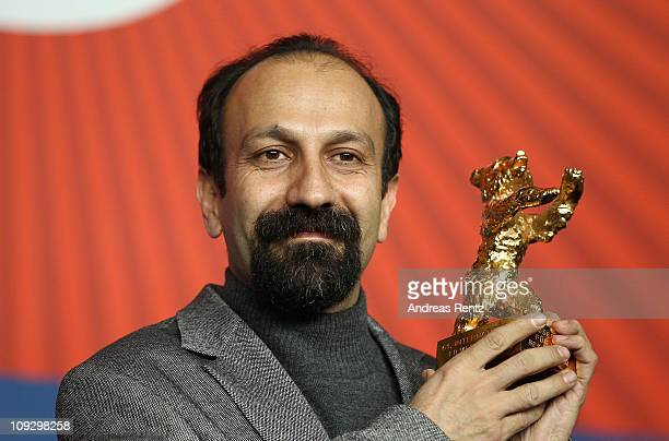 Iranian director Asghar Farhadi poses with the Golden Bear prize awarded for his film 'Jodaeiye Nader Az Simin' during the Award Winner Photocall...