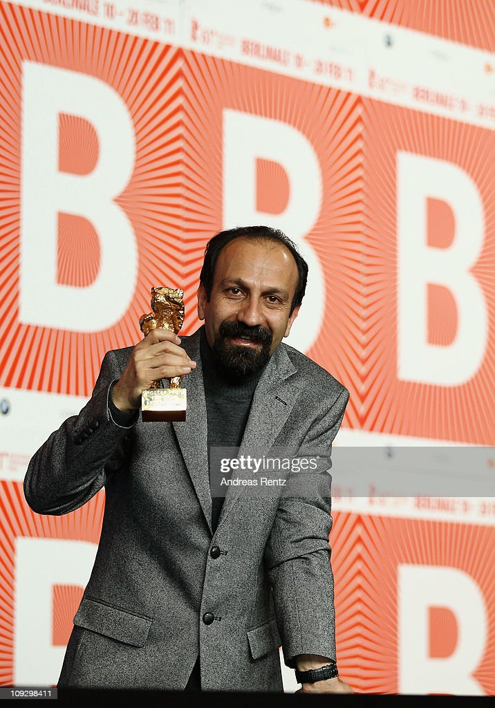 Iranian director <a gi-track='captionPersonalityLinkClicked' href=/galleries/search?phrase=Asghar+Farhadi&family=editorial&specificpeople=5700577 ng-click='$event.stopPropagation()'>Asghar Farhadi</a> poses with the Golden Bear prize awarded for his film 'Jodaeiye Nader Az Simin' (Nader And Simin, A Separation) during the Award Winner Photocall during day ten of the 61st Berlin International Film Festival at the Grand Hyatt on February 19, 2011 in Berlin, Germany.