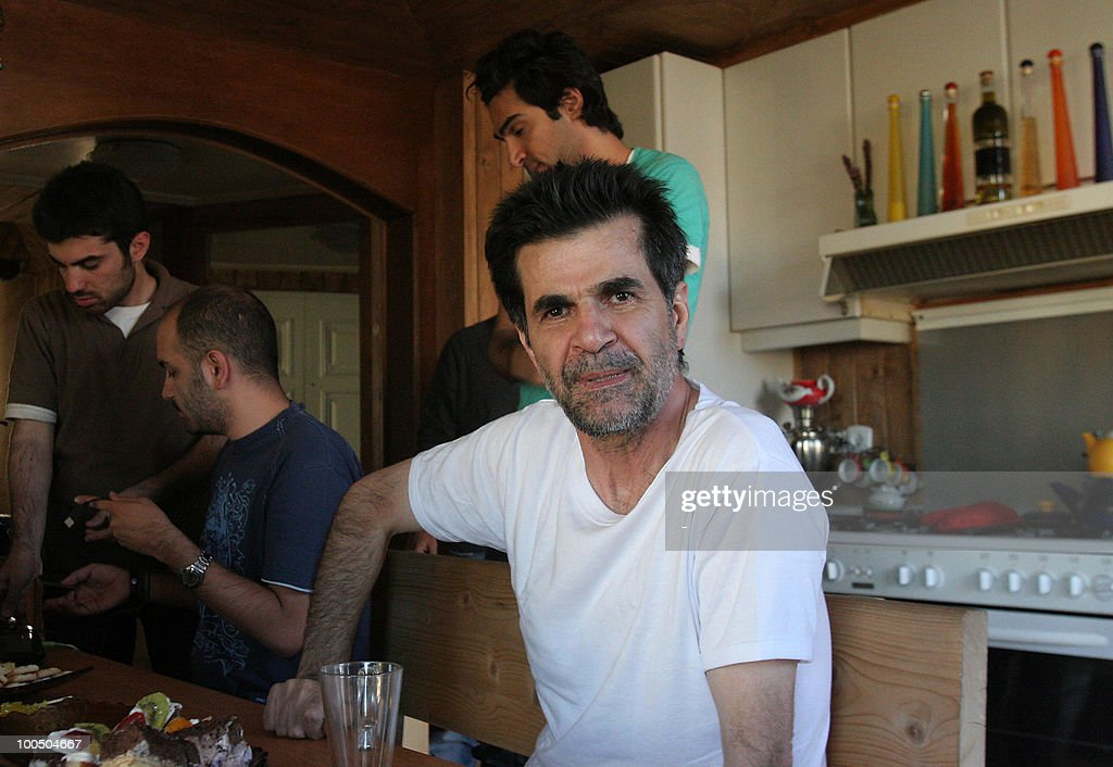 Iranian director Jafar Panahi sits at his home following his release from prison in Tehran on May 25, 2010. Panahi, who has been in custody since March, was released on bail, his wife told AFP, confirming a statement from the Tehran prosecutor's office.