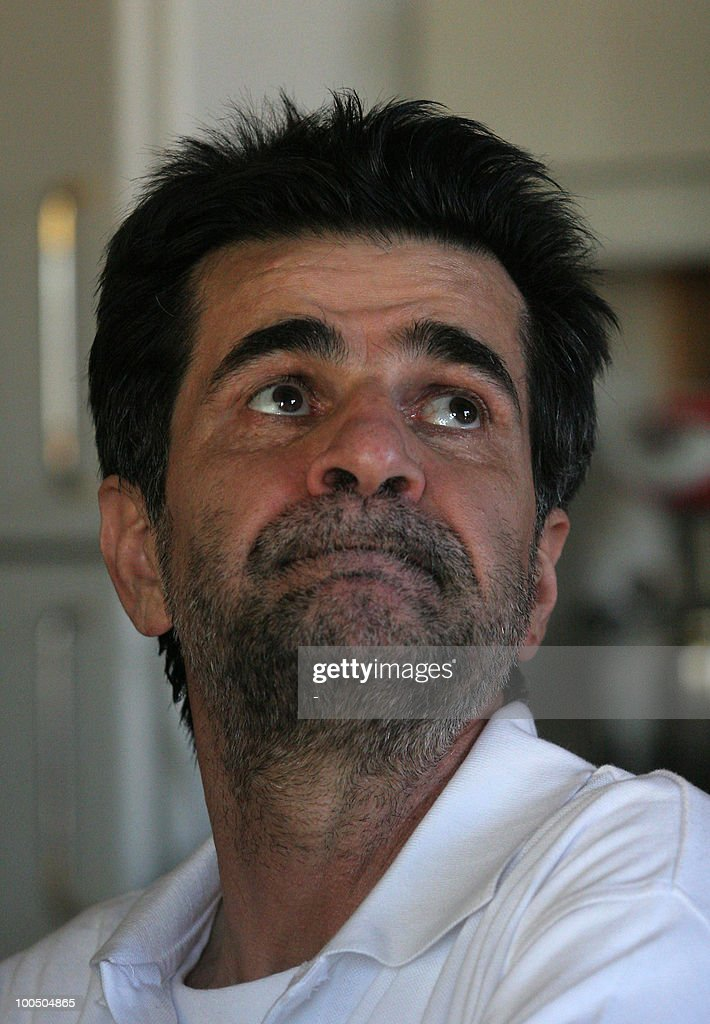 Iranian director Jafar Panahi sits at hi