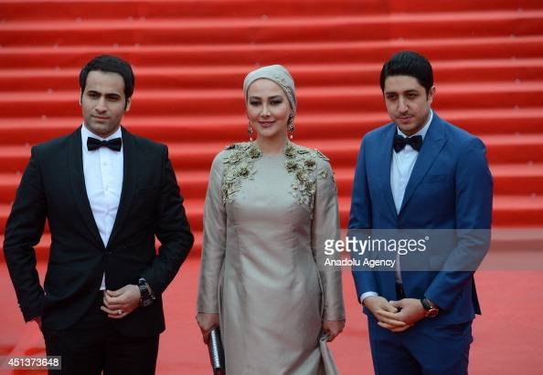 Iranian director MajidReza Mostafavi actress Ana Nemati and producer Arash Elyasi pose on the red carpet during the closing ceremony of the 36th...