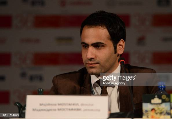 Iranian director MajidReza Mostafavi listens during press conference for the film Unripe Pomegranates during the 36th Moscow International Film...