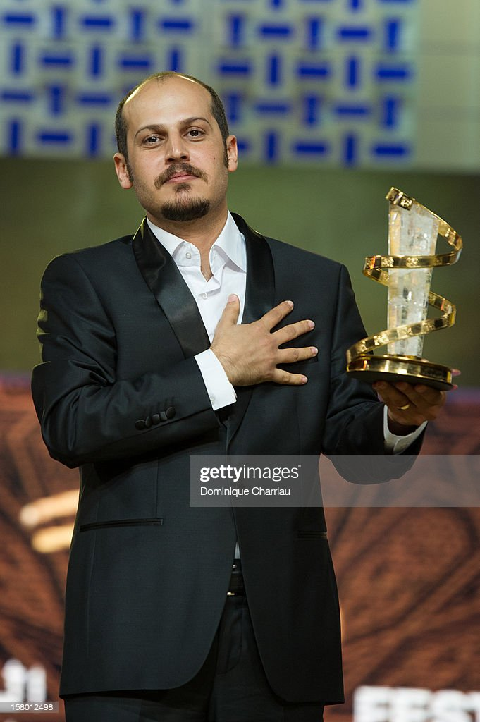Iranian director Vahid Vakilifara poses with the Jury Prize award for his film 'Taboor'during the award ceremony of the 12th International Marrakech Film Festival on December 8, 2012 in Marrakech, Morocco.