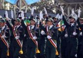 Iranian elite revolutionary guards march during an annual military parade which marks Iran's eightyear war with Iraq in the capital Tehran on...