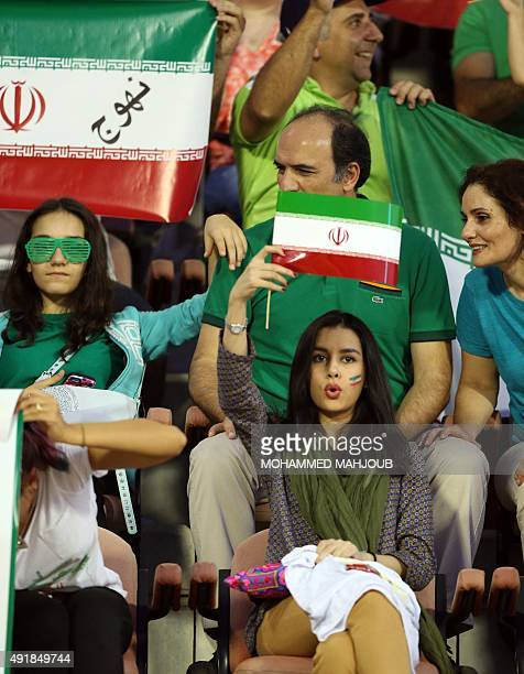Iranian fans hold their national flags during the AFC qualifying football match for the 2018 FIFA World Cup between Oman and Iran on October 8 2015...