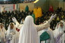 Iranian female students members of the hardline Basij Islamic militia sing in a choir during a gathering on the occasion of Student Basij Week in...