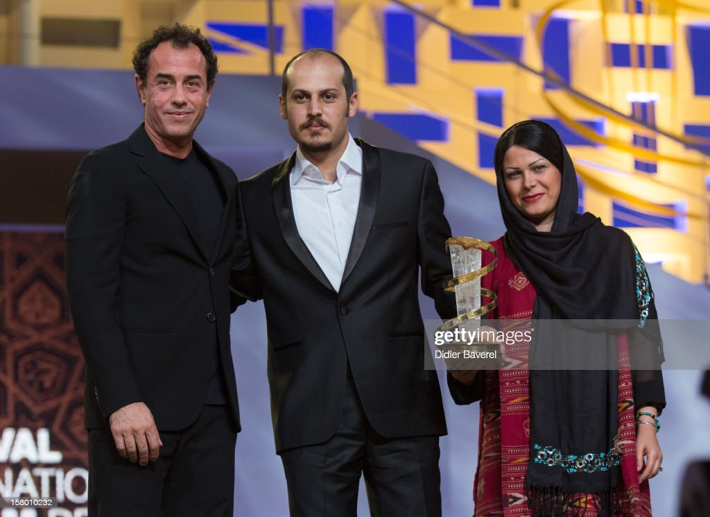 Iranian film director Vahid Vakilifara (R) receives the Jury Prize award from italian film director <a gi-track='captionPersonalityLinkClicked' href=/galleries/search?phrase=Matteo+Garrone&family=editorial&specificpeople=3086720 ng-click='$event.stopPropagation()'>Matteo Garrone</a> (L) for his film ' Taboor' at 12th International Marrakech Film Festival on December 8, 2012 in Marrakech, Morocco.