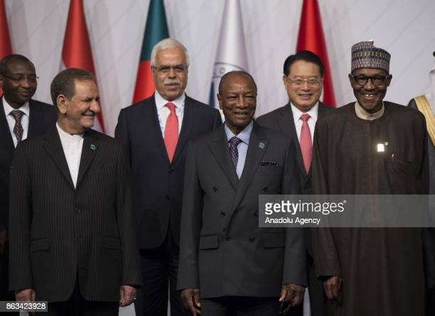 Iranian First Deputy President Ishak Cihangiri President of Nigeria Muhammed Buhari and President of Guinea Alpha Conde pose for a family photo...