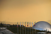 Iranian flags are near a silver dome exhibit hall in the recently opened Holy/Sacred Defense Museum a vast complex created by the Islamic...