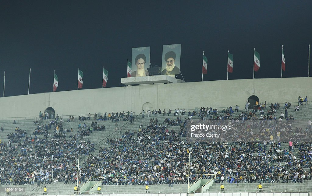 Iranian football fans gather under a huge poster of Ayatollah Khomeini (L) and Iranian President Mohammad Khatami at the Azadi Sports Complex on August 19, 2012 in Tehran, Iran.