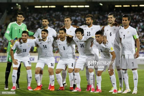 Iranian football players pose for a family photo during the 2018 World Cup qualifying football match between Iran and Uzbekistan at the Azadi Stadium...