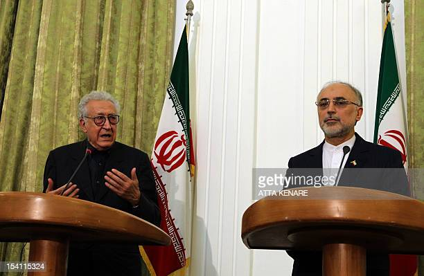 Iranian Foreign Minister Ali Akbar Salehi listens on as and International Peace envoy to Syria Lakhdar Brahimi speaks during a joint press conference...
