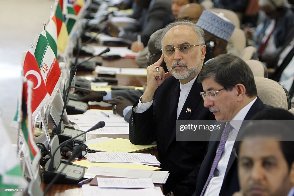 Iranian Foreign Minister Ali Akbar Salehi (L) looks past his Turkish counterpart Ahmet Davutoglu (2nd R) during the opening of a ministerial meeting in the Saudi Red Sea city of Jeddah, by the Organisation of Islamic Cooperation (OIC) on May 13, 2013. The OIC urged its member states to make generous contributions at this week's main donors conference on Mali to be held in Brussels, which aims to raise funds to repair the damage caused by the war against Islamists in the African country.