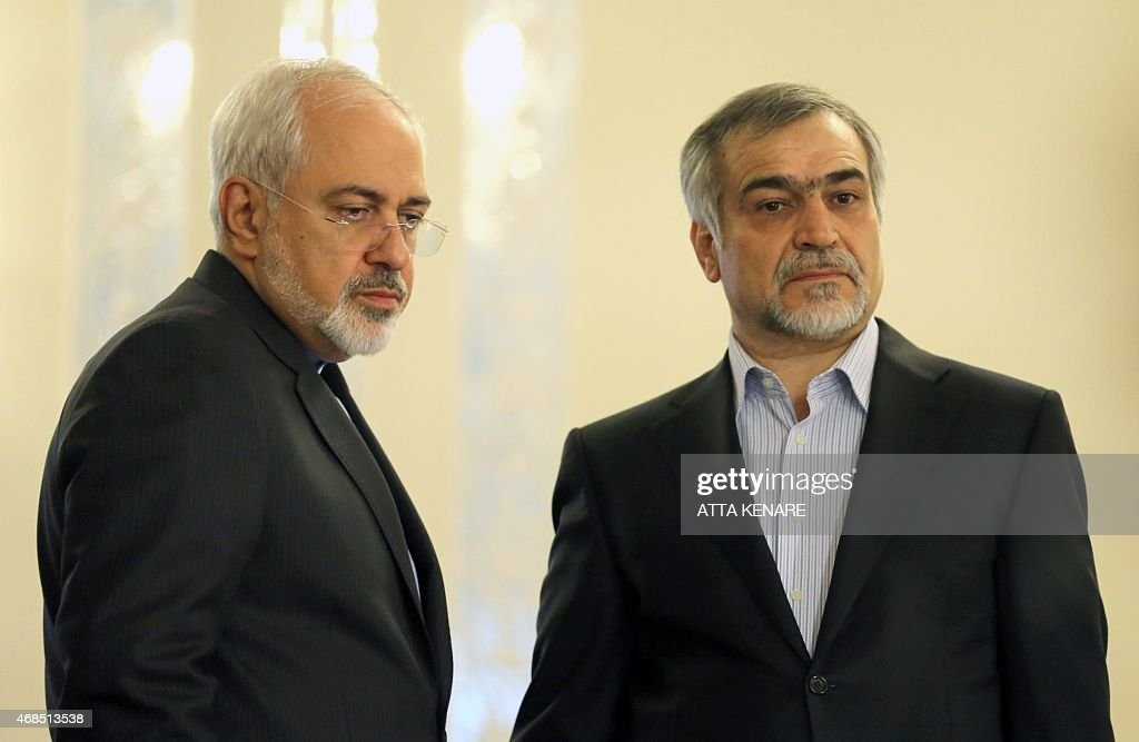 Iranian Foreign Minister Javad Zarif (L) and Hossein Fereydoun, President Rouhani's younger brother and advisor, look on during a press conference of President Hassan Rouhani (unseen) in Tehran on April 3, 2015. Iran vowed to stand by a nuclear deal with world powers as Rouhani promised it would open a 'new page' in the country's global ties.