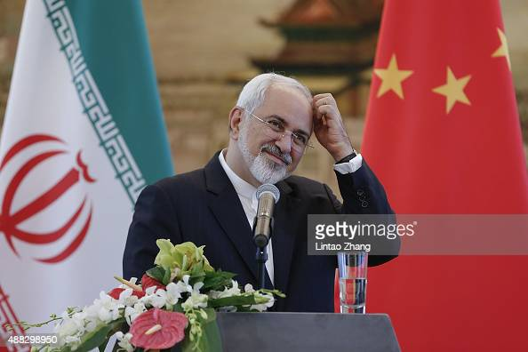 Iranian Foreign Minister Javad Zarif answer questions during a press conference after meeting with Chinas Foreign Minister Wang Yi on September 15...