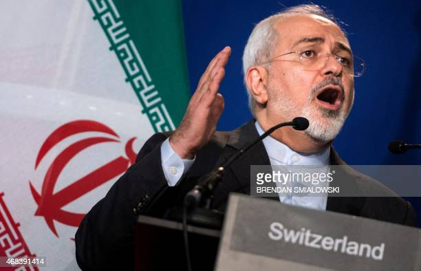Iranian Foreign Minister Javad Zarif gestures as he speaks during a press conference at the Swiss Federal Institute of Technology in Lausanne on...