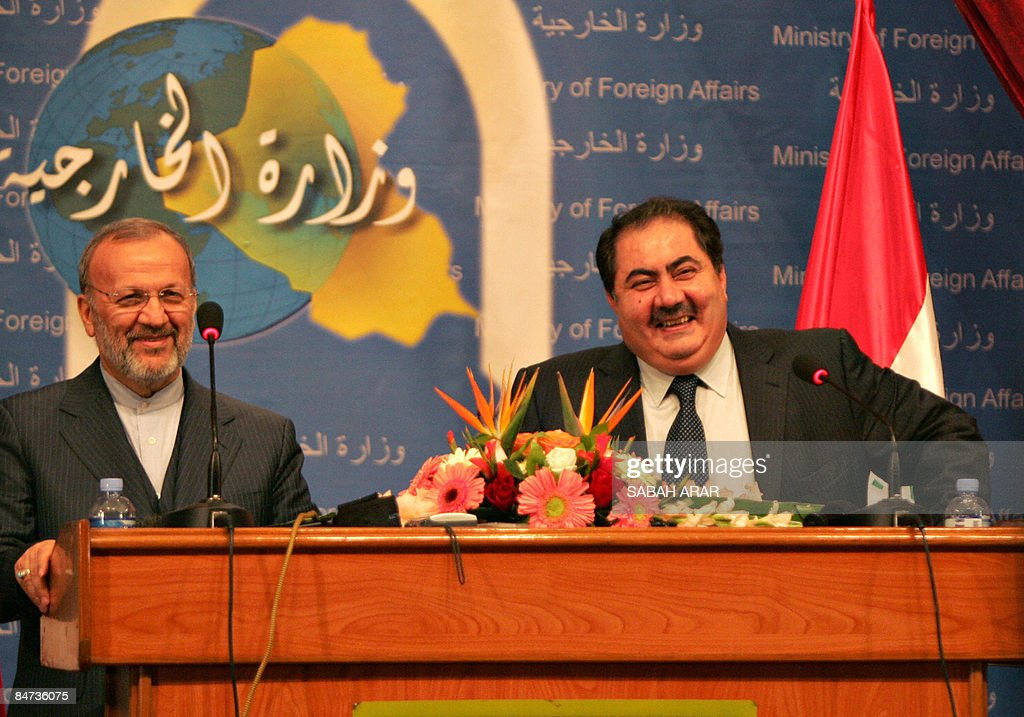 Iranian Foreign Minister Manouchehr Mottaki smiles during a joint press conference with Iraqi counterpart Hoshyar Zebari at the Foreign Ministry in...