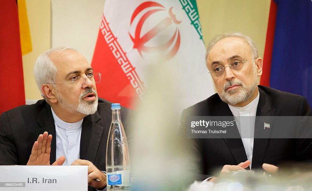 Iranian Foreign Minister <a gi-track='captionPersonalityLinkClicked' href=/galleries/search?phrase=Mohammad+Javad+Zarif&family=editorial&specificpeople=645041 ng-click='$event.stopPropagation()'>Mohammad Javad Zarif</a> (L) and Head of Iran Atomic Energy Organization <a gi-track='captionPersonalityLinkClicked' href=/galleries/search?phrase=Ali+Akbar+Salehi&family=editorial&specificpeople=3125551 ng-click='$event.stopPropagation()'>Ali Akbar Salehi</a> waits for the opening of a plenary session on Iran nuclear talks at the Beau Rivage Palace Hotel in Lausanne on April 02, 2015.
