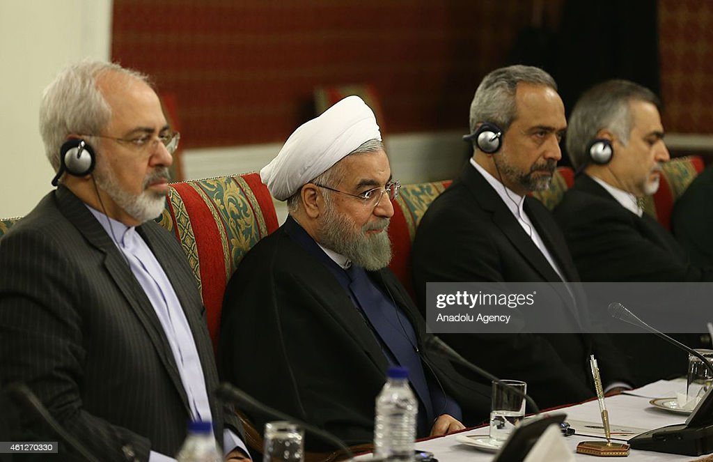 Iranian Foreign Minister Mohammad Javad Zarif and Iranian President Hassan Rouhani attend a meeting with Venezuelan President Nicolas Maduro at the...