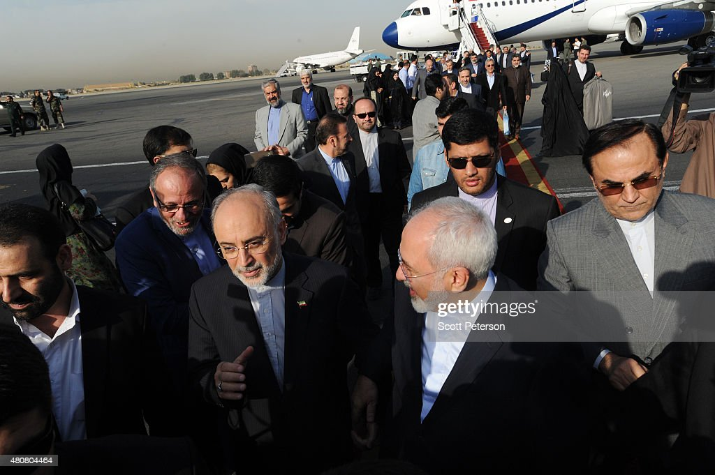 Iranian Foreign Minister <a gi-track='captionPersonalityLinkClicked' href=/galleries/search?phrase=Mohammad+Javad+Zarif&family=editorial&specificpeople=645041 ng-click='$event.stopPropagation()'>Mohammad Javad Zarif</a> (right) and the head of Iran's Atomic Energy Organization <a gi-track='captionPersonalityLinkClicked' href=/galleries/search?phrase=Ali+Akbar+Salehi&family=editorial&specificpeople=3125551 ng-click='$event.stopPropagation()'>Ali Akbar Salehi</a> touch down on Iranian soil after signing a landmark nuclear deal between Iran and six world powers, in Tehran, Iran, on July 15, 2015. The bite of years of sanctions on the Islamic Republic and three years of roller-coaster nuclear talks have taken a toll on Iran, where President Hassan Rouhani has pledged to resolve the nuclear crisis and improve the economy.