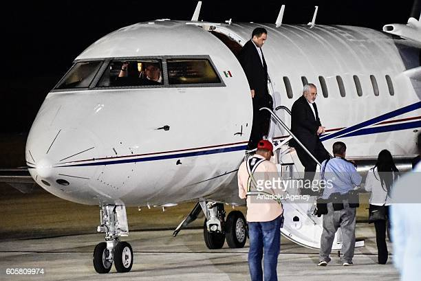 Iranian Foreign Minister Mohammad Javad Zarif gets off an airplane as he arrives at the General en Jefe Santiago Marino airport to attend the...