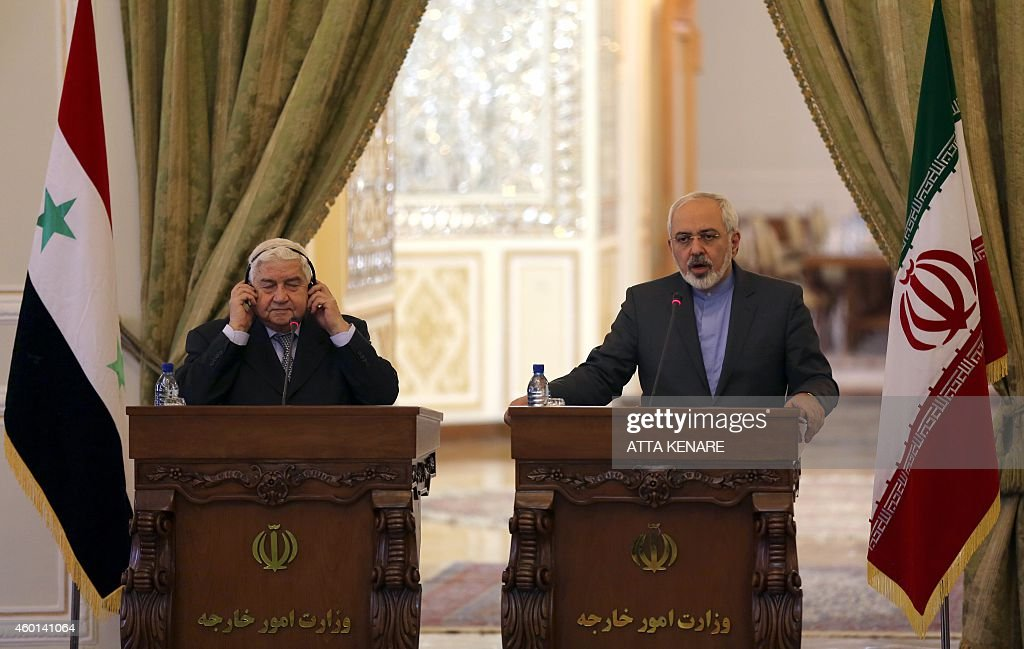 Iranian Foreign Minister Mohammad Javad Zarif holds a press conference with his Syrian counterpart Walid Muallem in Tehran on December 8 ahead of a...