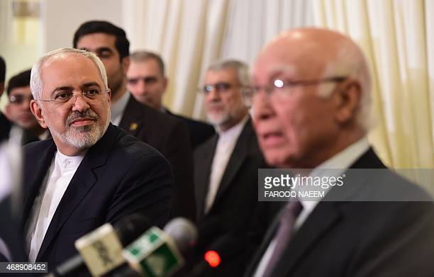 Iranian Foreign Minister Mohammad Javad Zarif listens during a joint press briefing with Advisor to Pakistani Prime Minister on Foreign Affairs...
