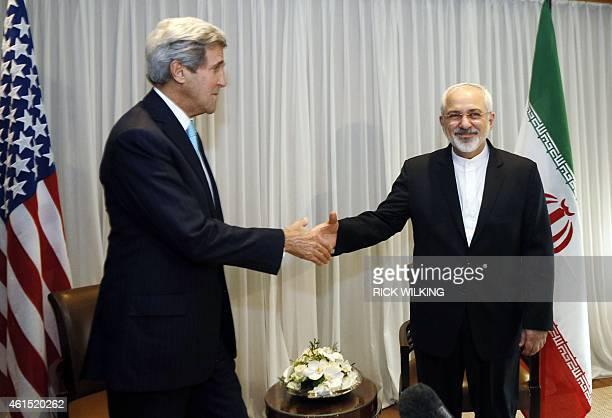 Iranian Foreign Minister Mohammad Javad Zarif shakes hands on January 14 2015 with US State Secretary John Kerry in Geneva Zarif said on January 14...