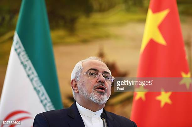 Iranian Foreign Minister Mohammad Javad Zarif speaks during a joint press conference with Chinese Foreign Minister Wang Yi on December 5 2016 in...
