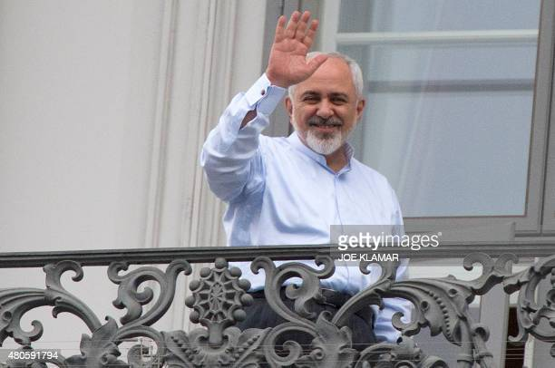 Iranian Foreign Minister Mohammad Javad Zarif waves from a balcony of the Palais Coburg Hotel where the Iran nuclear talks meetings are being held in...