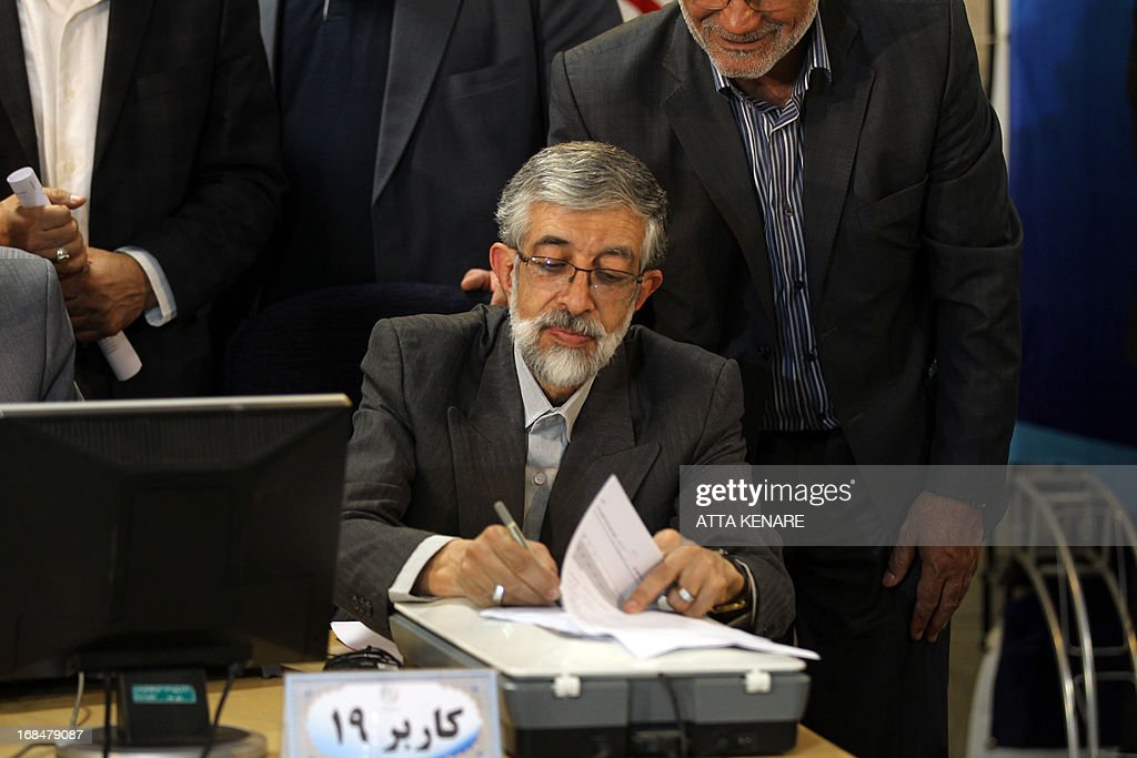 Iranian former parliament speaker Gholam Ali Haddad Adel registers his candidacy for the upcoming presidential election at the interior ministry in Tehran on May 10, 2013. Iran began a five-day registration period for candidates in Iran's June 14 presidential election, with a string of conservative hopefuls in the running but with key reformists yet to come forward, media reports said. AFP PHOTO/ATTA KENARE