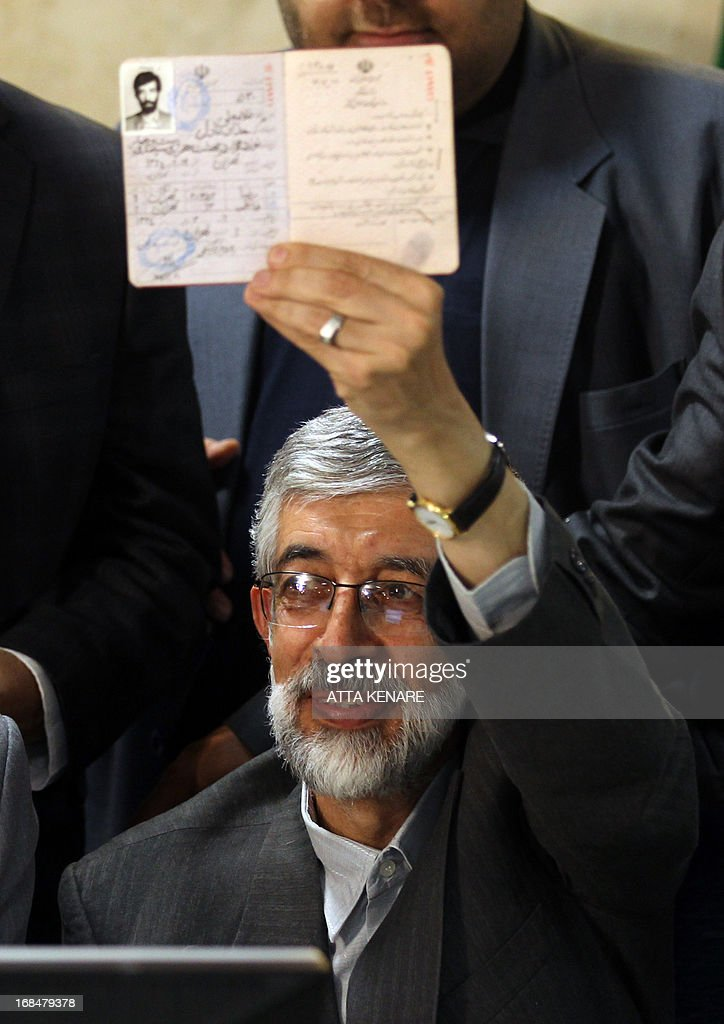 Iranian former parliament speaker, Gholam Ali Haddad Adel shows his Identification Document as he registers his candidacy for the upcoming presidential election at the interior ministry in Tehran on May 10, 2013. Iran began a five-day registration period for candidates in Iran's June 14 presidential election, with a string of conservative hopefuls in the running but with key reformists yet to come forward, media reports said.