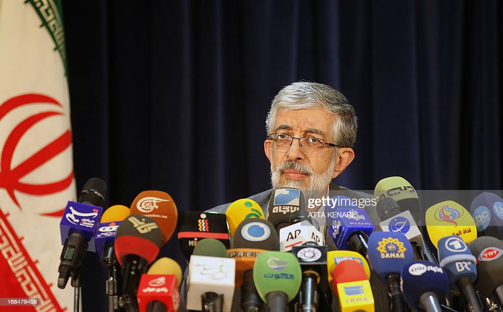 Iranian former parliament speaker, Gholam Ali Haddad Adel speaks to journalists after he registered his candidacy for the upcoming presidential election at the interior ministry in Tehran on May 10, 2013. Iran began a five-day registration period for candidates in Iran's June 14 presidential election, with a string of conservative hopefuls in the running but with key reformists yet to come forward, media reports said.
