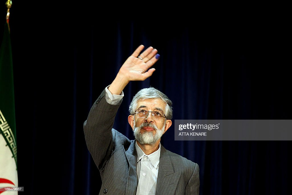 Iranian former parliament speaker Gholam Ali Haddad Adel waves as he registers his candidacy for the upcoming presidential election at the interior ministry in Tehran on May 10, 2013. Iran began a five-day registration period for candidates in Iran's June 14 presidential election, with a string of conservative hopefuls in the running but with key reformists yet to come forward, media reports said. AFP PHOTO/ATTA KENARE