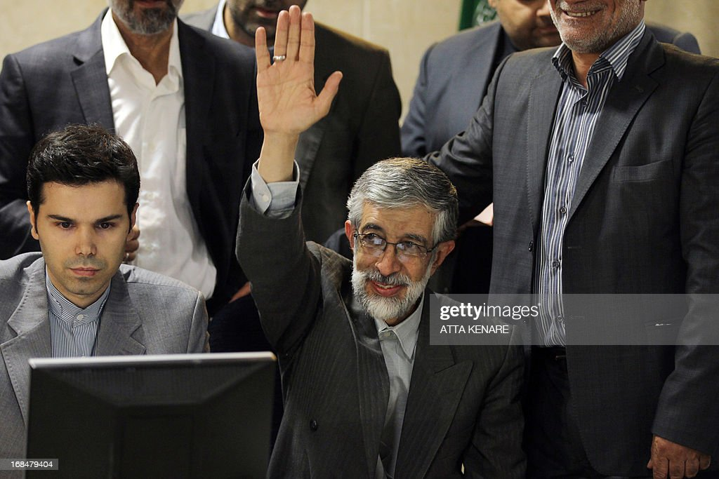 Iranian former parliament speaker, Gholam Ali Haddad Adel waves as he registers his candidacy for the upcoming presidential election at the interior ministry in Tehran on May 10, 2013. Iran began a five-day registration period for candidates in Iran's June 14 presidential election, with a string of conservative hopefuls in the running but with key reformists yet to come forward, media reports said.