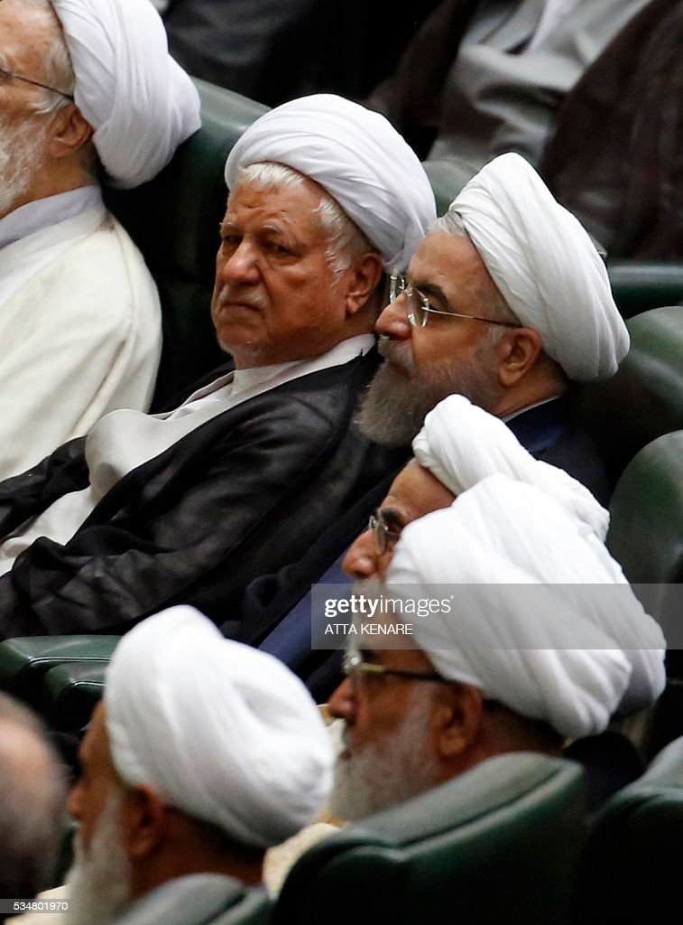 Iranian former president Ayatollah Akbar Hashemi Rafsanjani (top-L), President Hasan Rouhani (top-R) and newly elected head of the Assembly of Experts, Ahmad Jannati (C), attend the opening session of the new parliament in Tehran on May 28, 2016. / AFP / ATTA