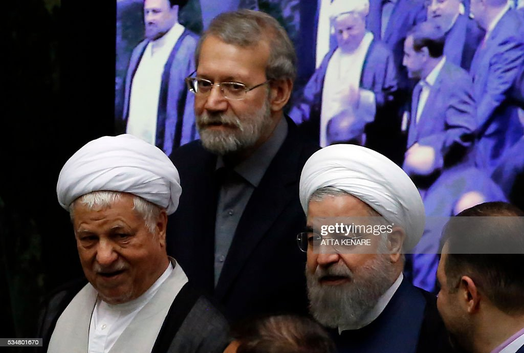 Iranian former president Ayatollah Akbar Hashemi Rafsanjani (L), Parliament Speaker Ali Larijani (C) and President Hasan Rouhani attend the opening session of the new parliament in Tehran on May 28, 2016. Iranian parliamentarians met in Tehran for the first time since elections finished in April. KENARE