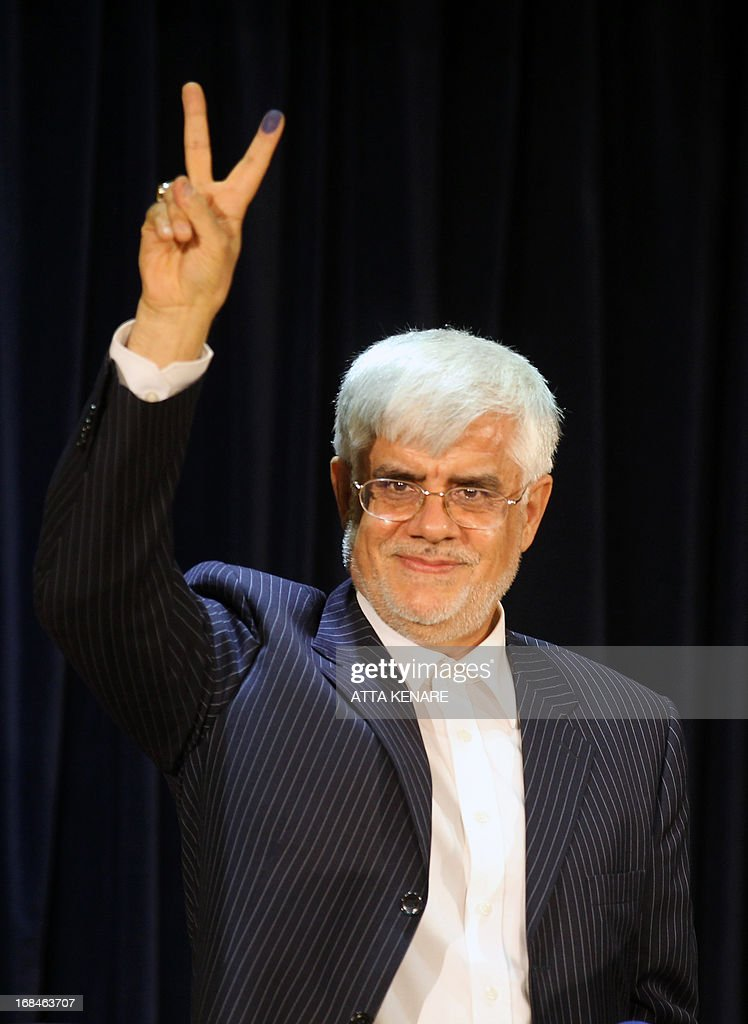 Iranian former Vice-President Mohammad Reza Aref flashes the sign of victory after he registered his candidacy for the upcoming presidential election at the interior ministry in Tehran on May 10, 2013. Iran began a five-day registration period for candidates in Iran's June 14 presidential election, with a string of conservative hopefuls in the running but with key reformists yet to come forward, media reports said.
