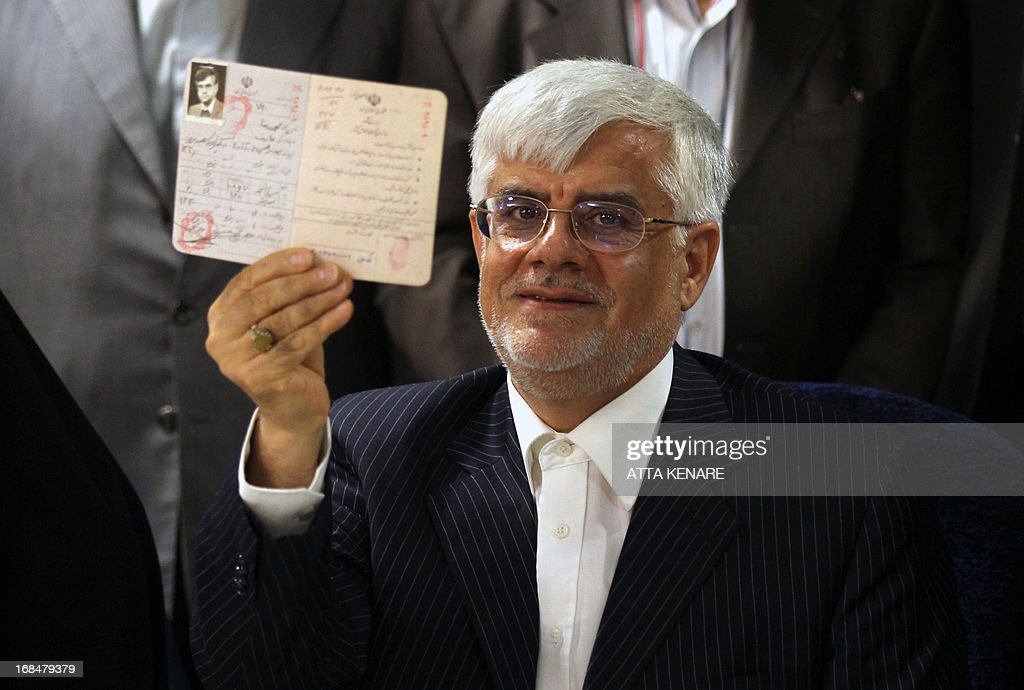 Iranian former Vice-President Mohammad Reza Aref shows his Identification Document as he registers his candidacy for the upcoming presidential election at the interior ministry in Tehran on May 10, 2013. Iran began a five-day registration period for candidates in Iran's June 14 presidential election, with a string of conservative hopefuls in the running but with key reformists yet to come forward, media reports said.